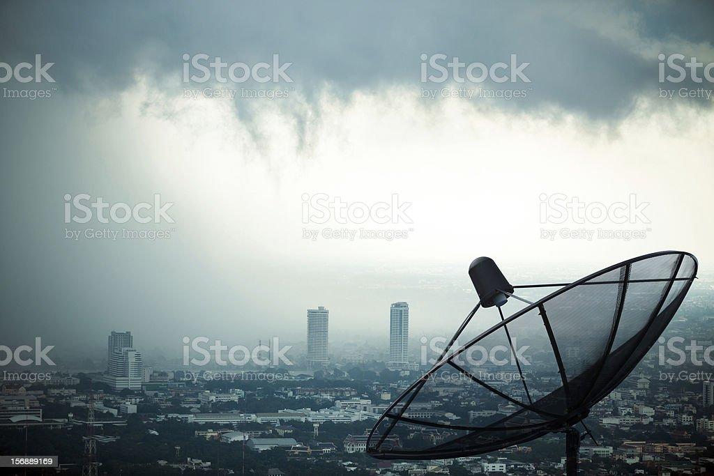 Antenna communication satellite dish with storm background stock photo