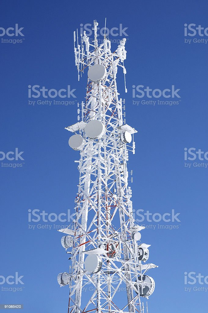 Antenna communications tower covered in snow royalty-free stock photo