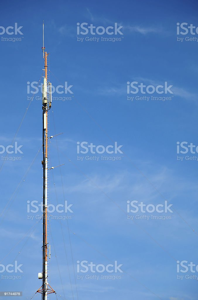 Antenna in the blue sky stock photo