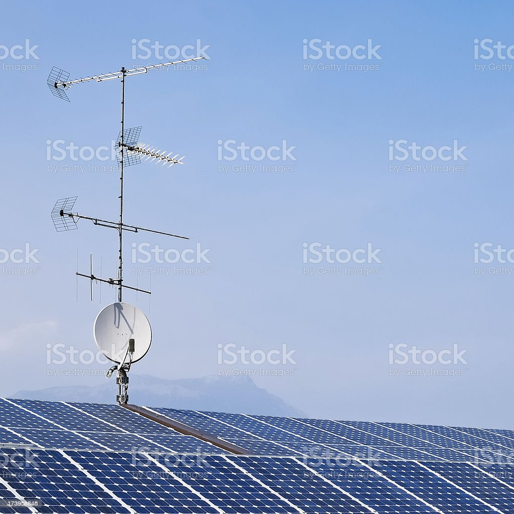 antenna on roof with solar panels stock photo