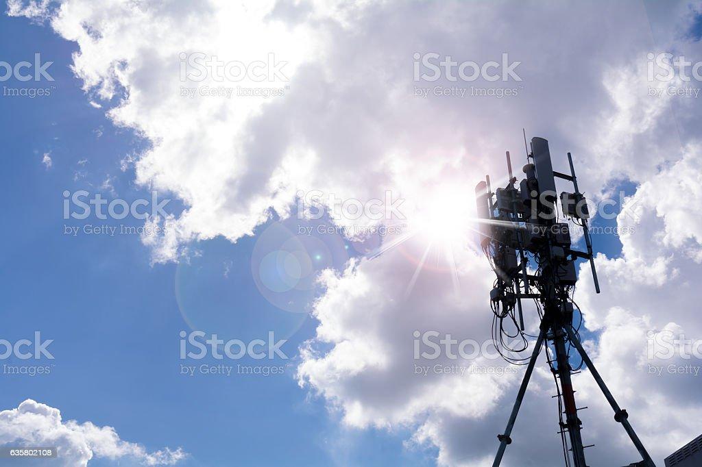 Antenna smart phone tower against sunburst. stock photo