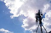 Antenna smart phone tower against sunburst.