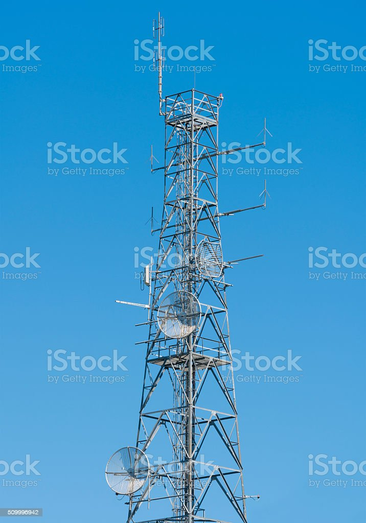 Antenna tower on top of a hill stock photo