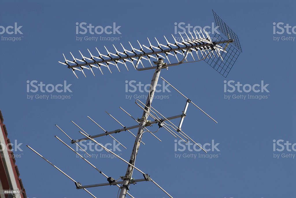 Antennas of different types. Global communications on house roof. royalty-free stock photo