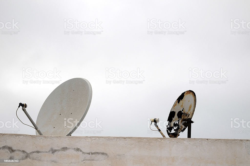 Antennas on a Roof over  Cloudy Sky royalty-free stock photo