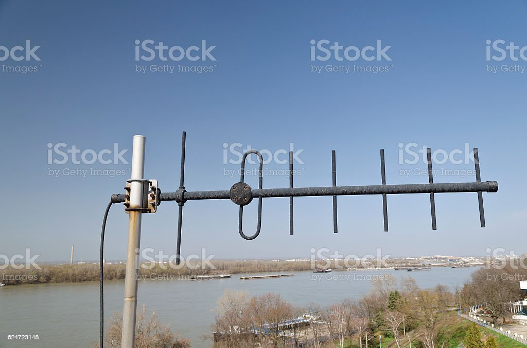 TV antennas on the roof with a beautiful blue sky stock photo