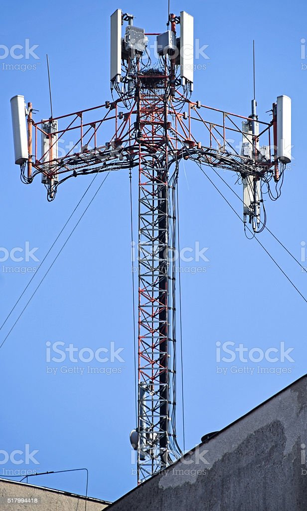 Antennas on the top of a building stock photo