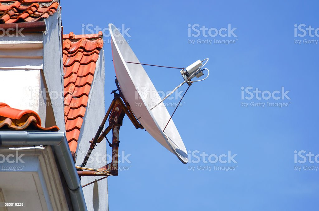 Antennas to receive TV signals on the roof stock photo