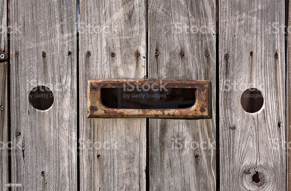 Anthropomorphic Face In A Rustic Wooden Fence royalty-free stock photo