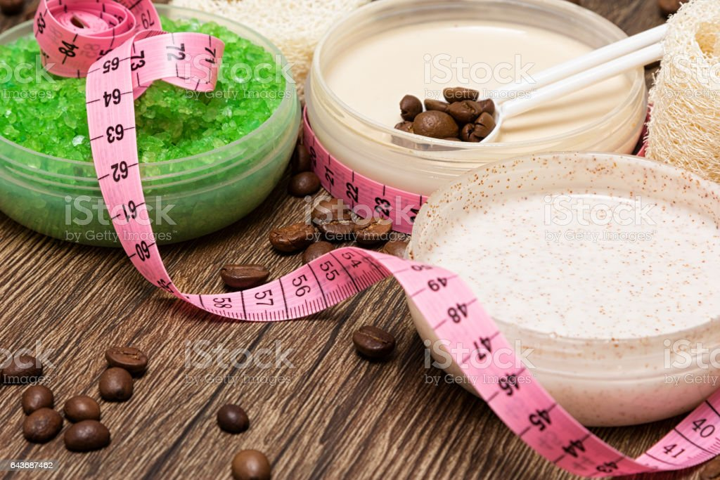 Anti cellulite cosmetic products with body measuring tape stock photo