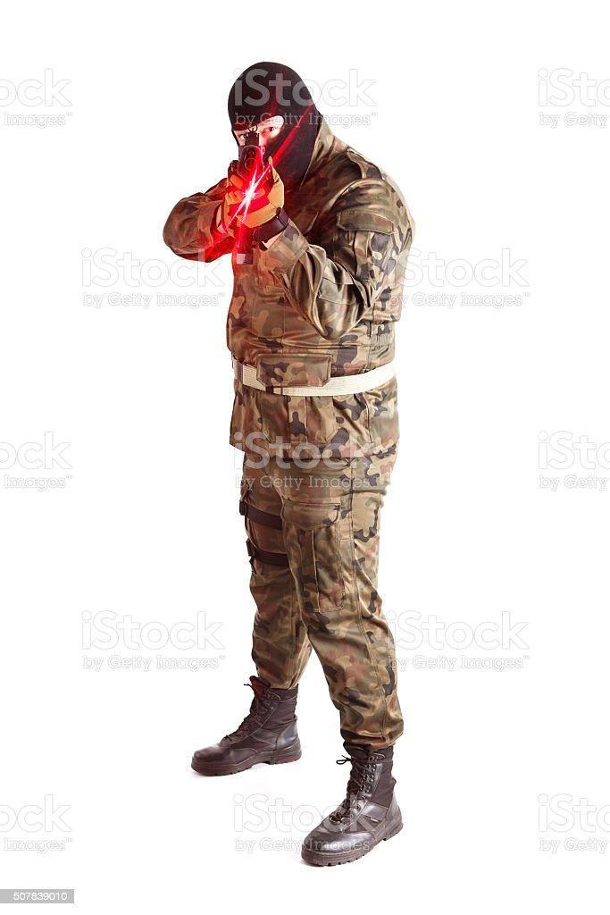 Anti terrorist pointing at camera gun with red laser sight stock photo