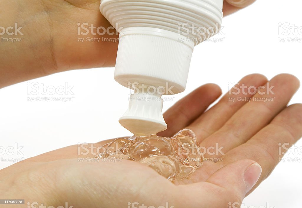 Antibacterial gel being squirted onto a hand stock photo