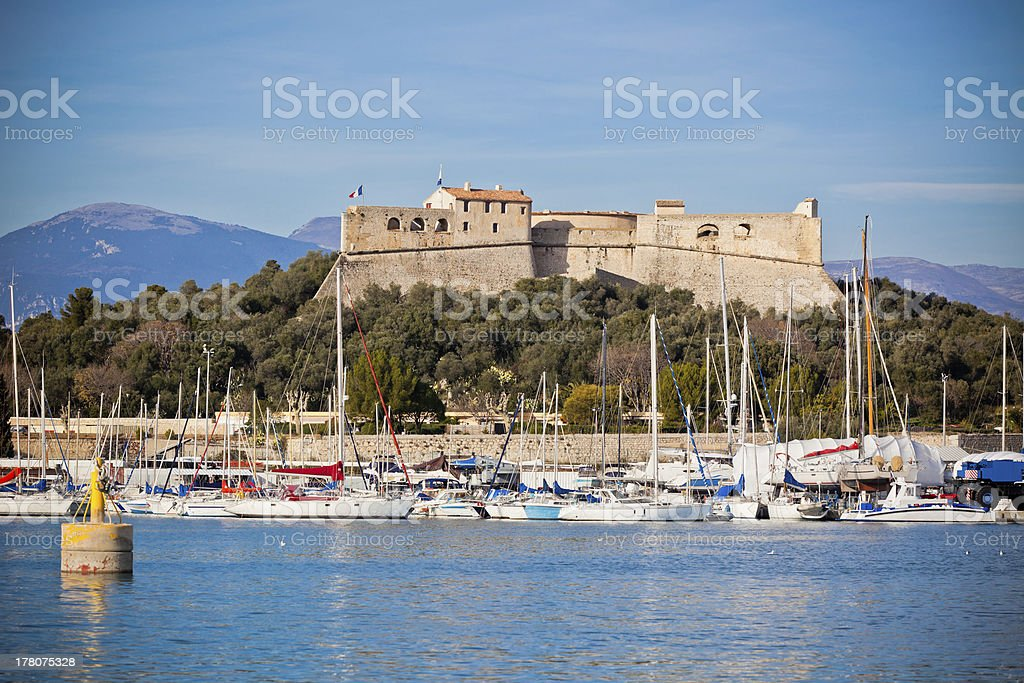 Antibes harbor, France, with yachts and Fort Carre stock photo