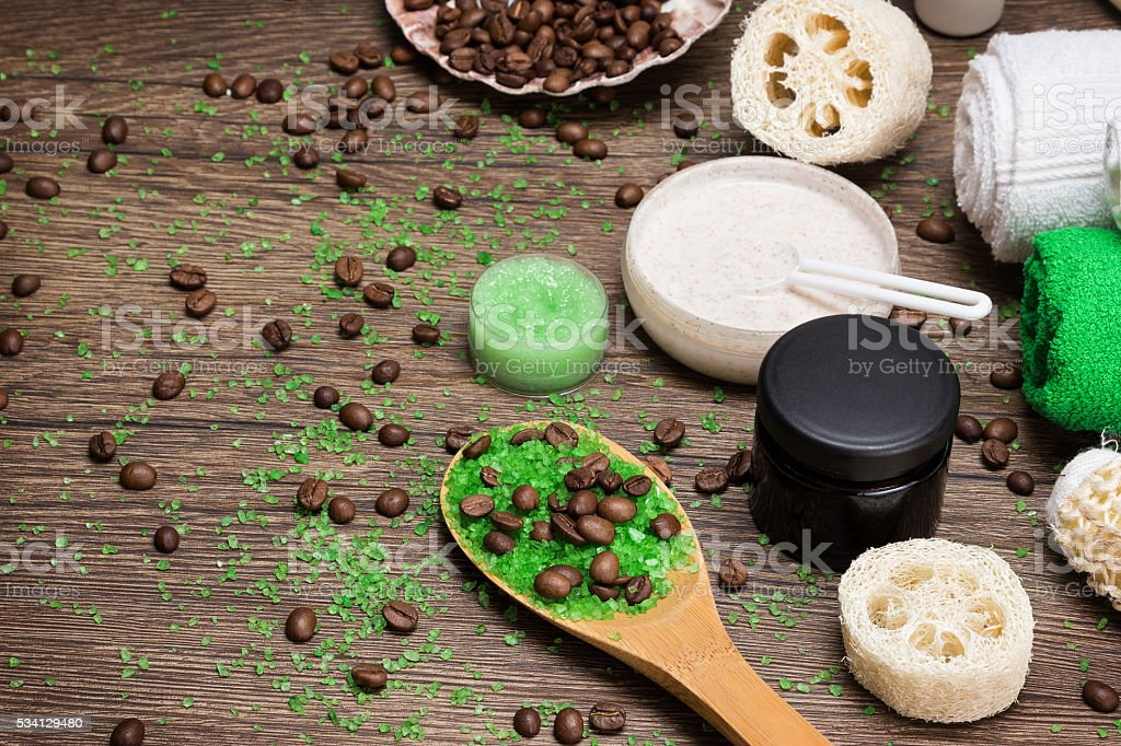 Anti-cellulite cosmetics with caffeine on wooden surface stock photo