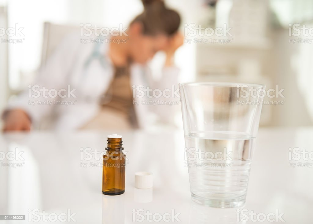 Antidepressant on table and doctor woman in background. Closeup stock photo