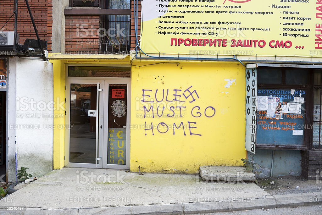 Anti-EULEX graffiti in North Mitrovica, Kosovo royalty-free stock photo