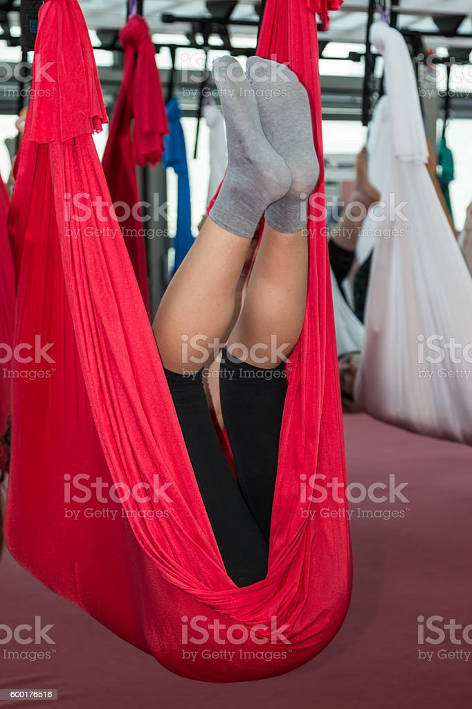 Antigravity Fitness with Red Hammock, Air Yoga and Flying Fitnes stock photo