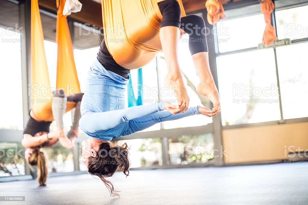 Antigravity Yoga Woman in Class royalty-free stock photo