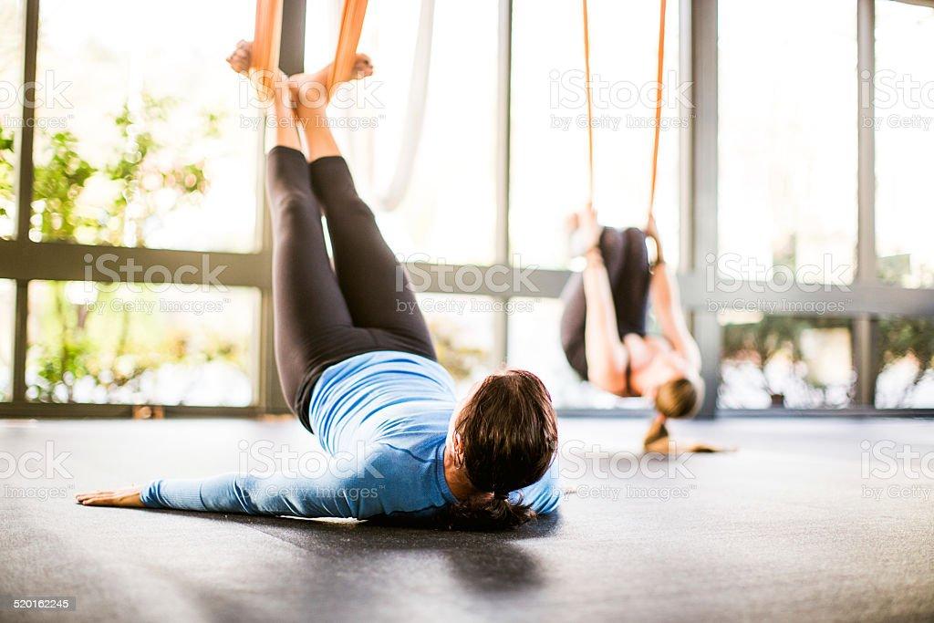Antigravity Yoga Woman in Class stock photo