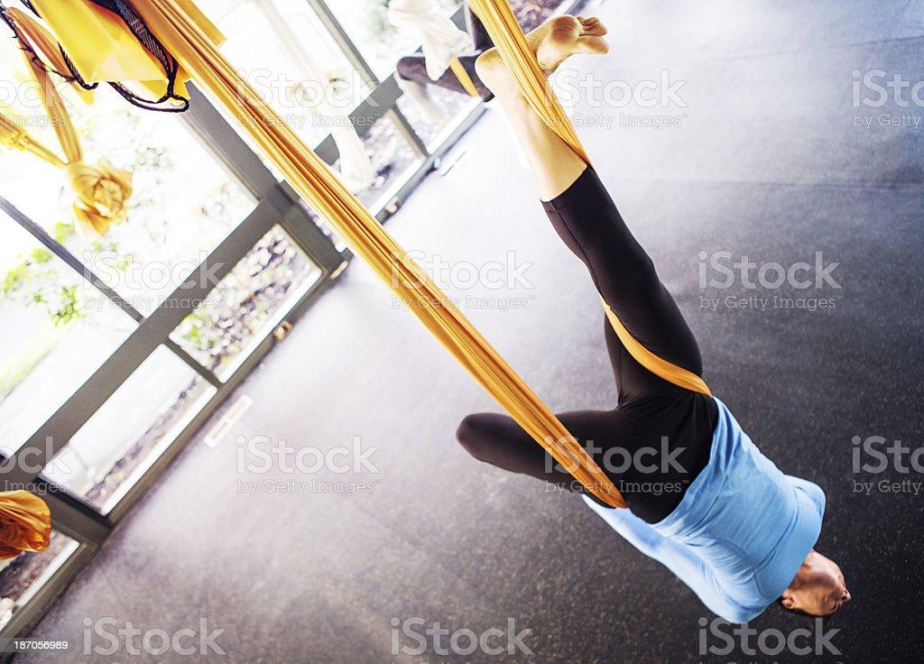 Antigravity Yoga Woman Suspended stock photo