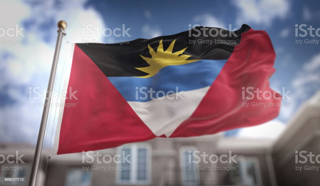 Antigua and Barbuda  Flag 3D Rendering on Blue Sky Building Background stock photo