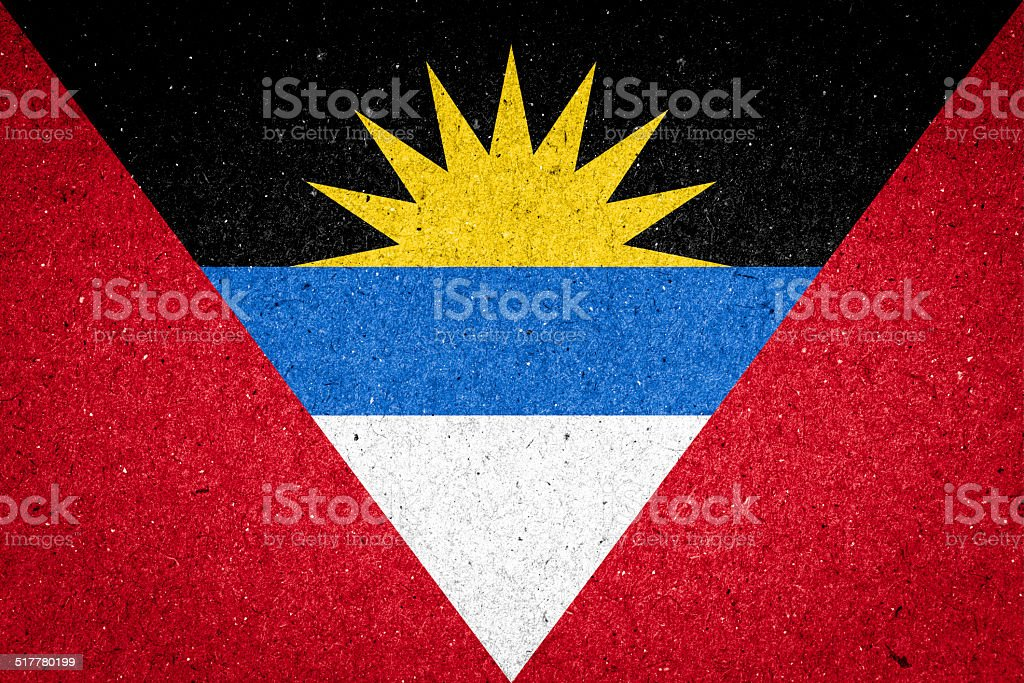 Antigua and Barbuda flag on paper background stock photo