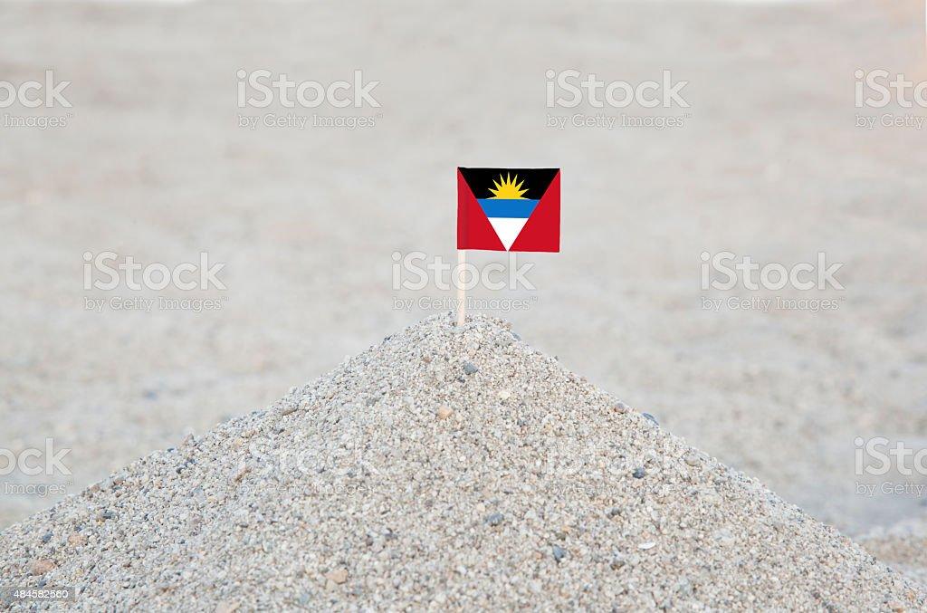 Antigua and Barbuda Flag on the Beach stock photo