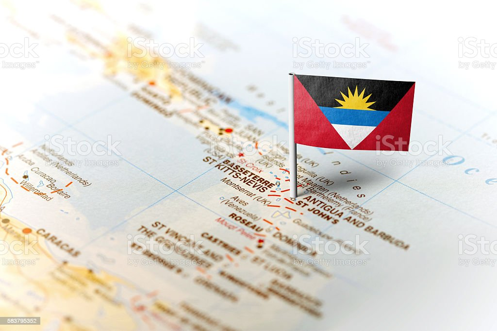 Antigua and Barbuda pinned on the map with flag stock photo