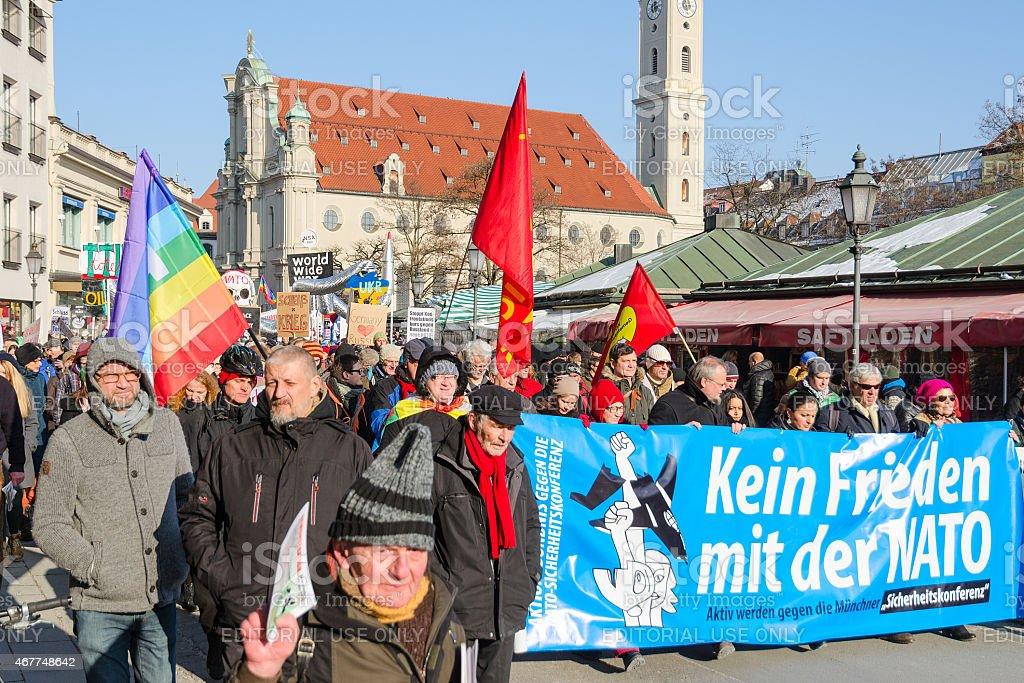 Anti-NATO protest march against aggressive policy USA in Europe stock photo