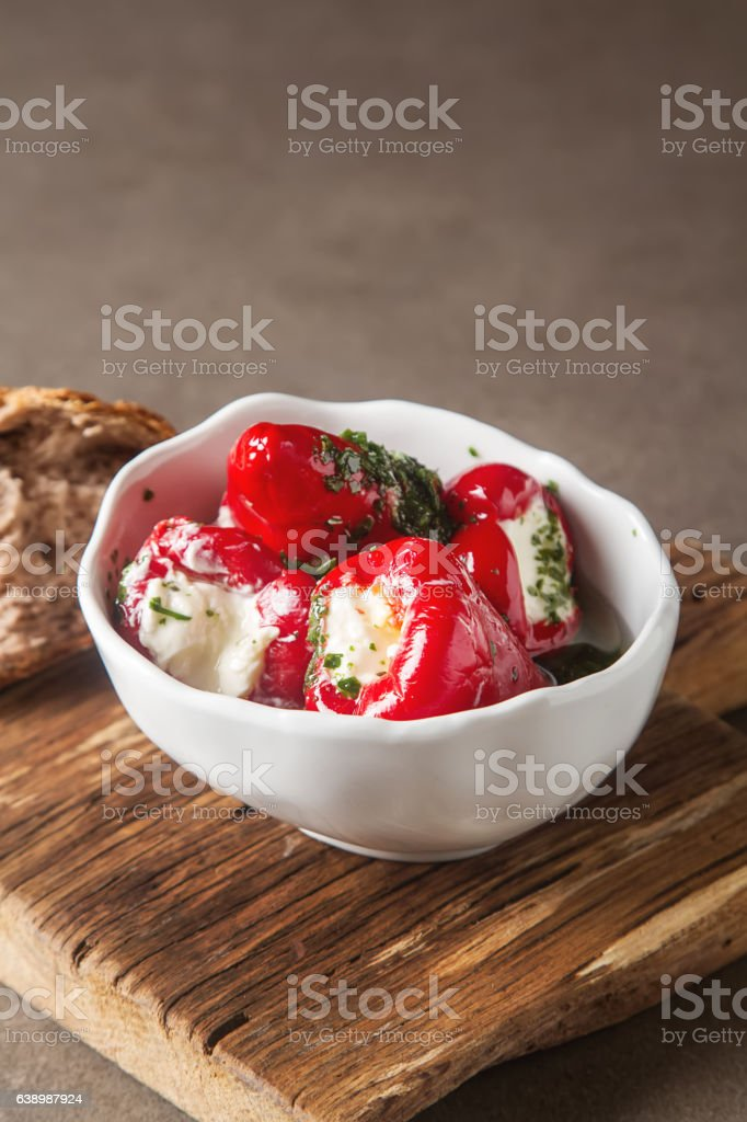 Antipasti Appetizer sweet cherry peppers stuffed with soft cheese feta. stock photo
