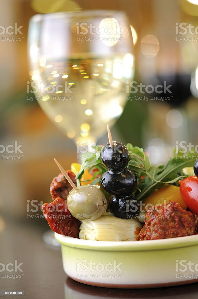 Antipasti with white wine royalty-free stock photo