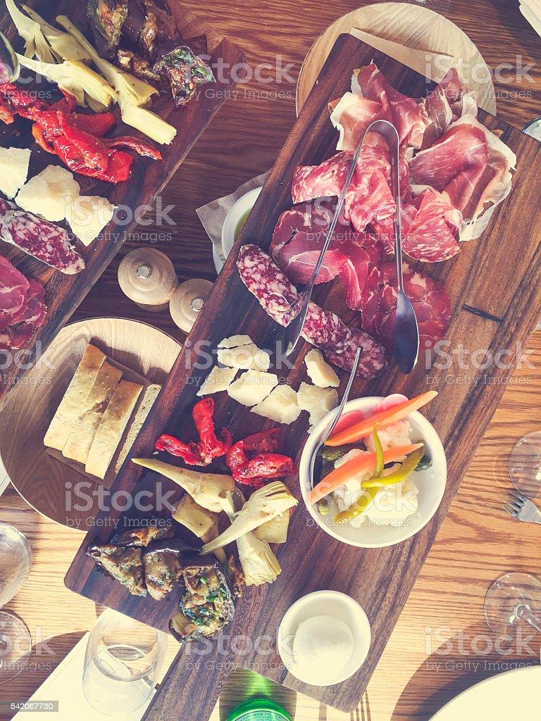 Antipasto board on a restaurant table. stock photo