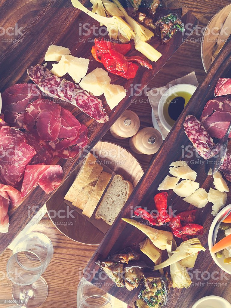 Antipasto board on a restaurant table. stock photo