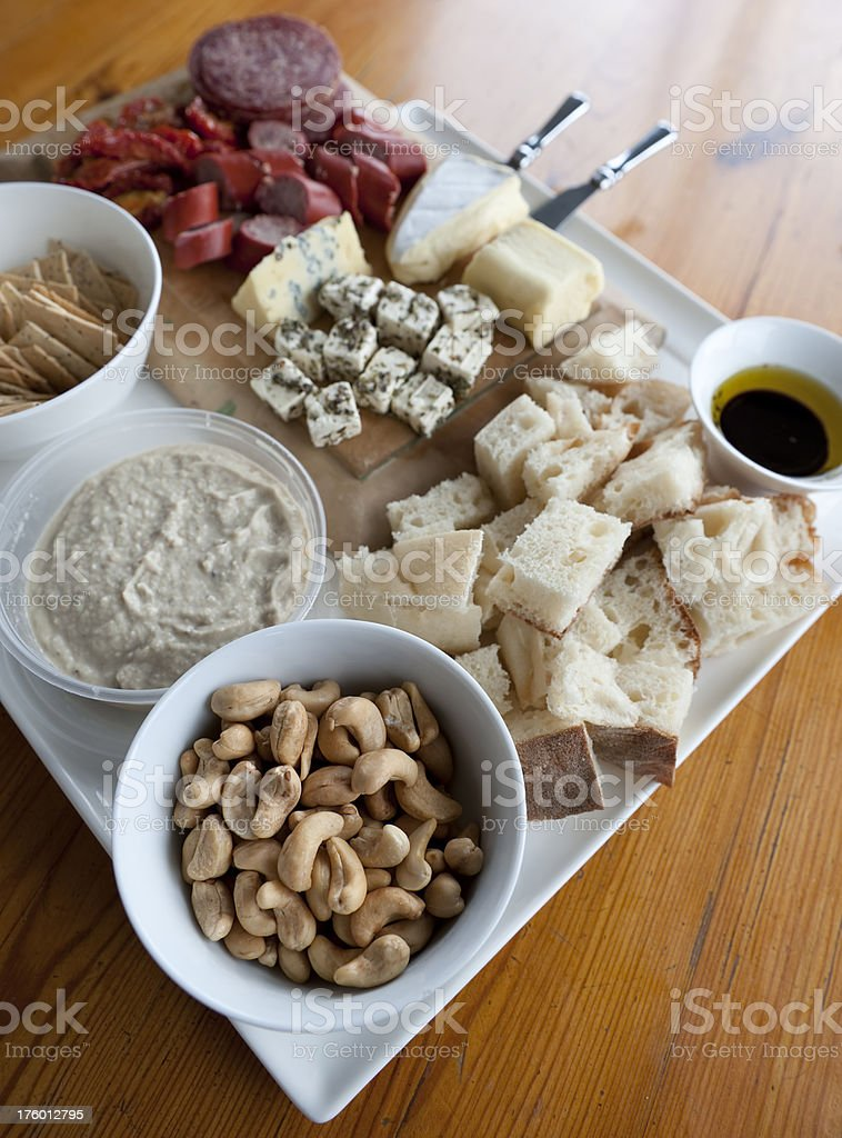 Antipasto canapes nibbles snacks gourmet delight white square platter stock photo