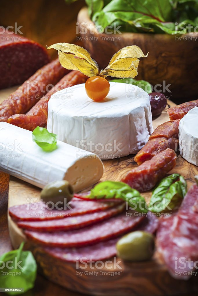 Antipasto catering platter with different meat and cheese products royalty-free stock photo
