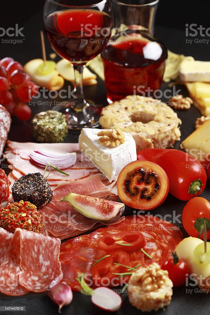 Antipasto catering platter with red wine royalty-free stock photo