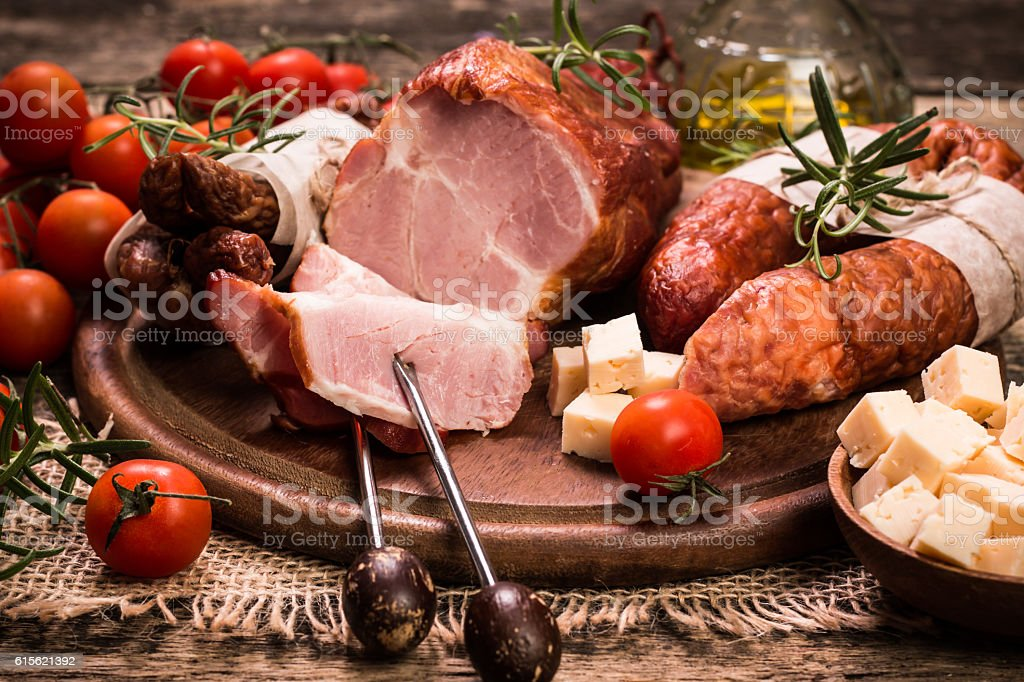 Antipasto catering platter with salami and meat on a wood stock photo
