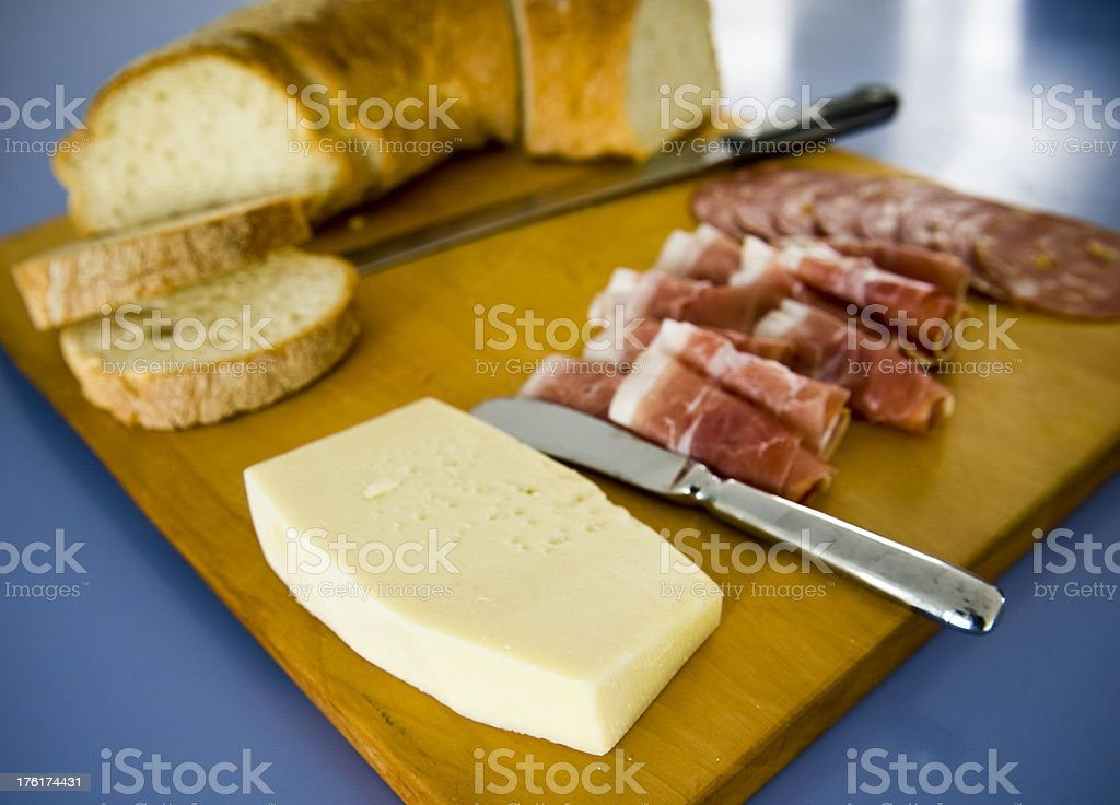 Antipasto Continental cheese prosciutto  platter food crusty bread royalty-free stock photo