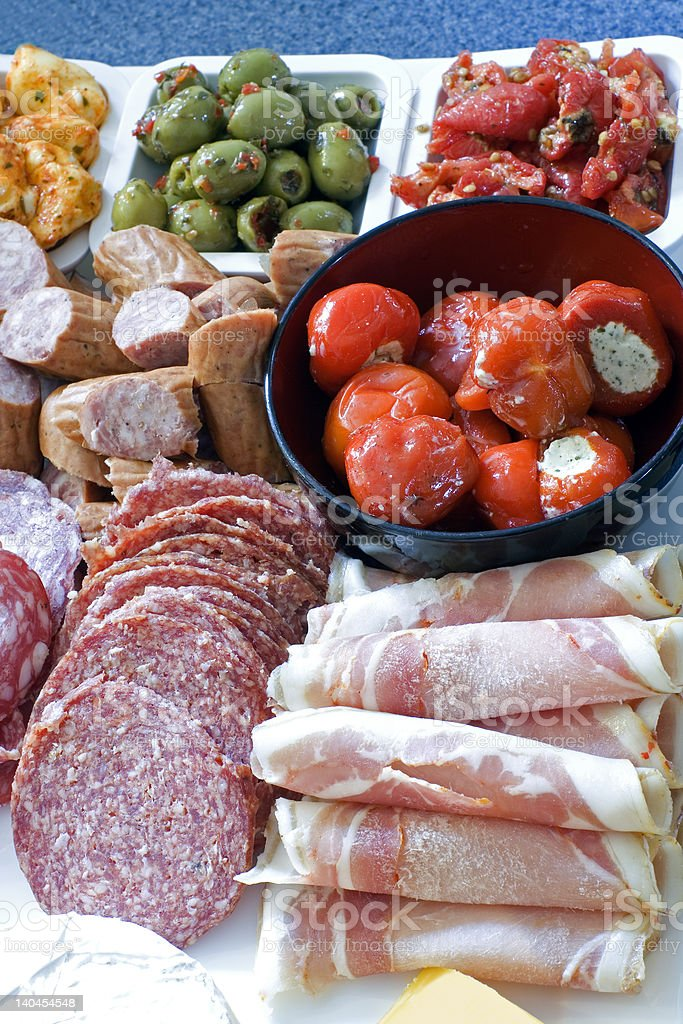 Antipasto; meat, olives, peppers, cheese stock photo