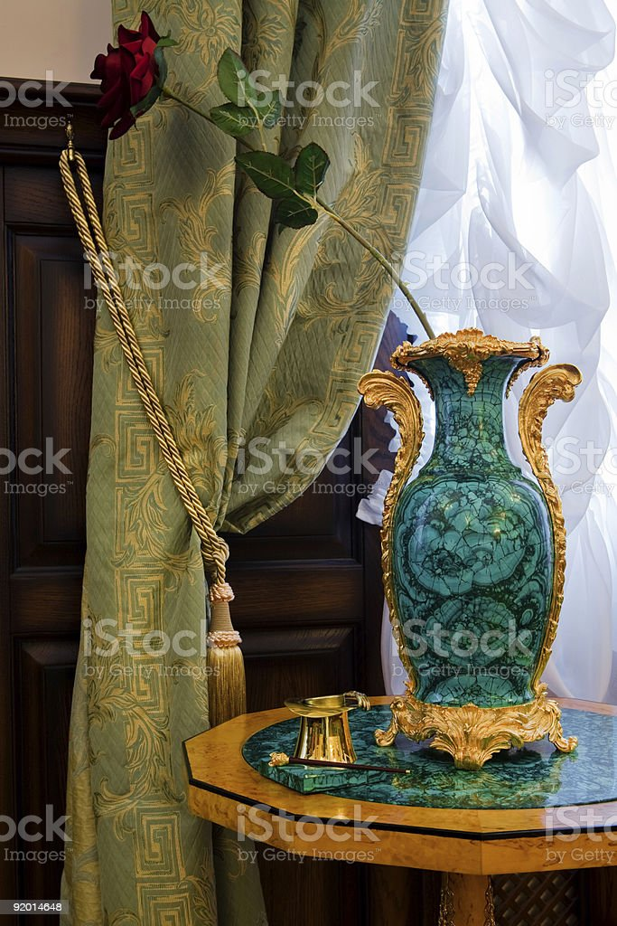 antiquarian vase at a window royalty-free stock photo