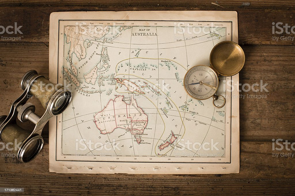 Antique 1870 Map of Australia, Binoculars, and Compass on Trunk royalty-free stock photo