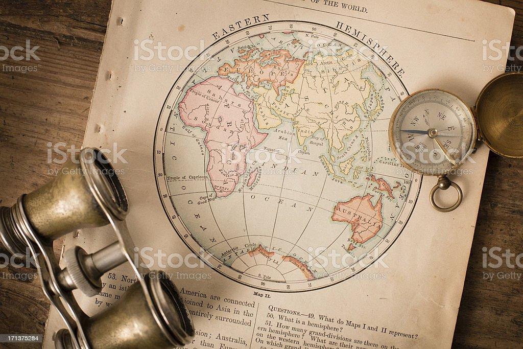 Antique 1870 Map of Eastern Hemisphere, Binoculars, and Compass stock photo