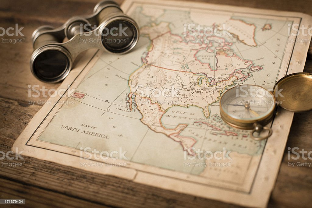 Antique 1870 Map of North America, Binoculars, and Compass stock photo