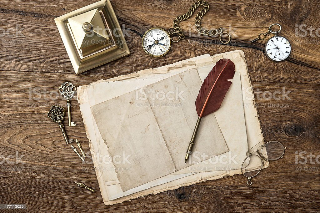 antique accessories and office supplies on wooden table royalty-free stock photo