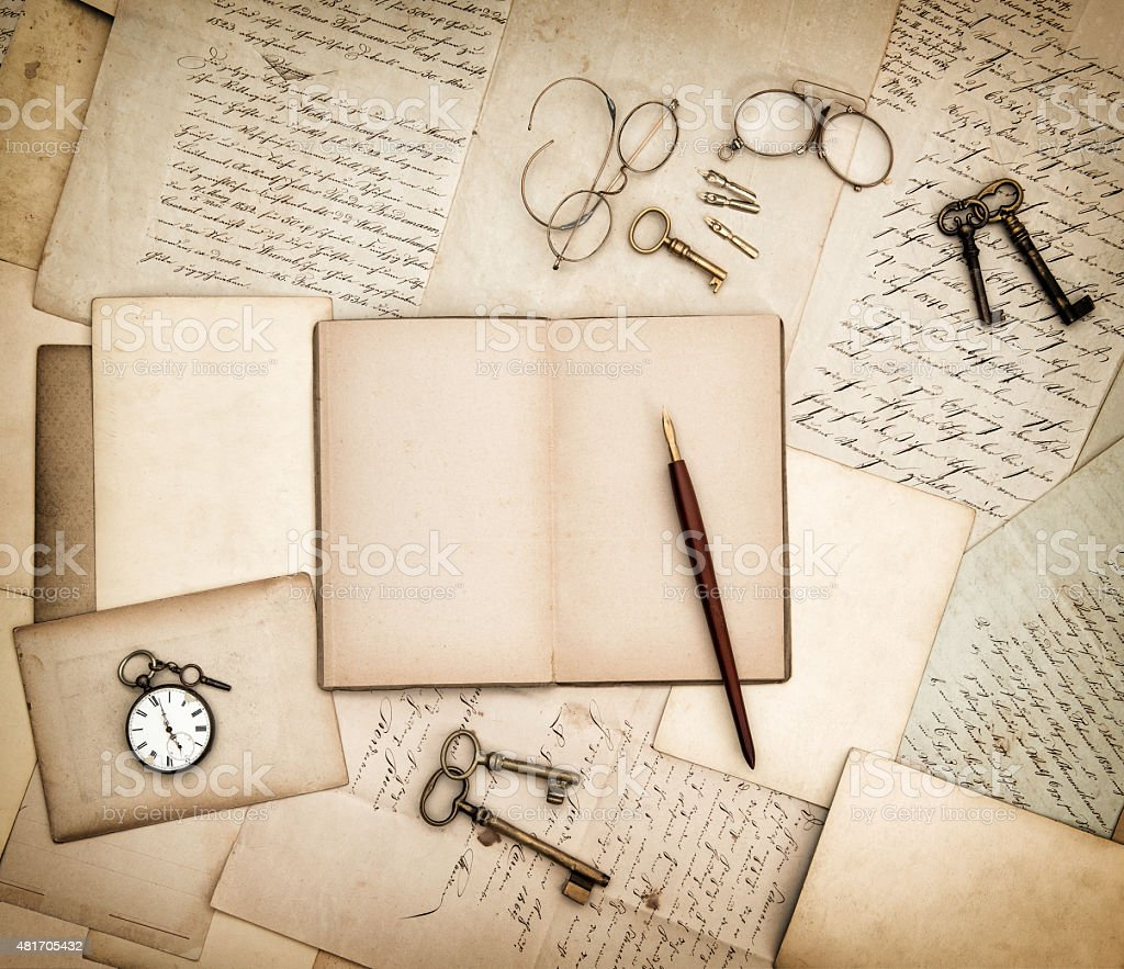 Antique accessories, old letters, pocket watch and keys. Vintage background stock photo