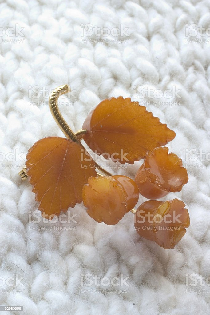 antique amber leaf broach on thick cotton knit royalty-free stock photo