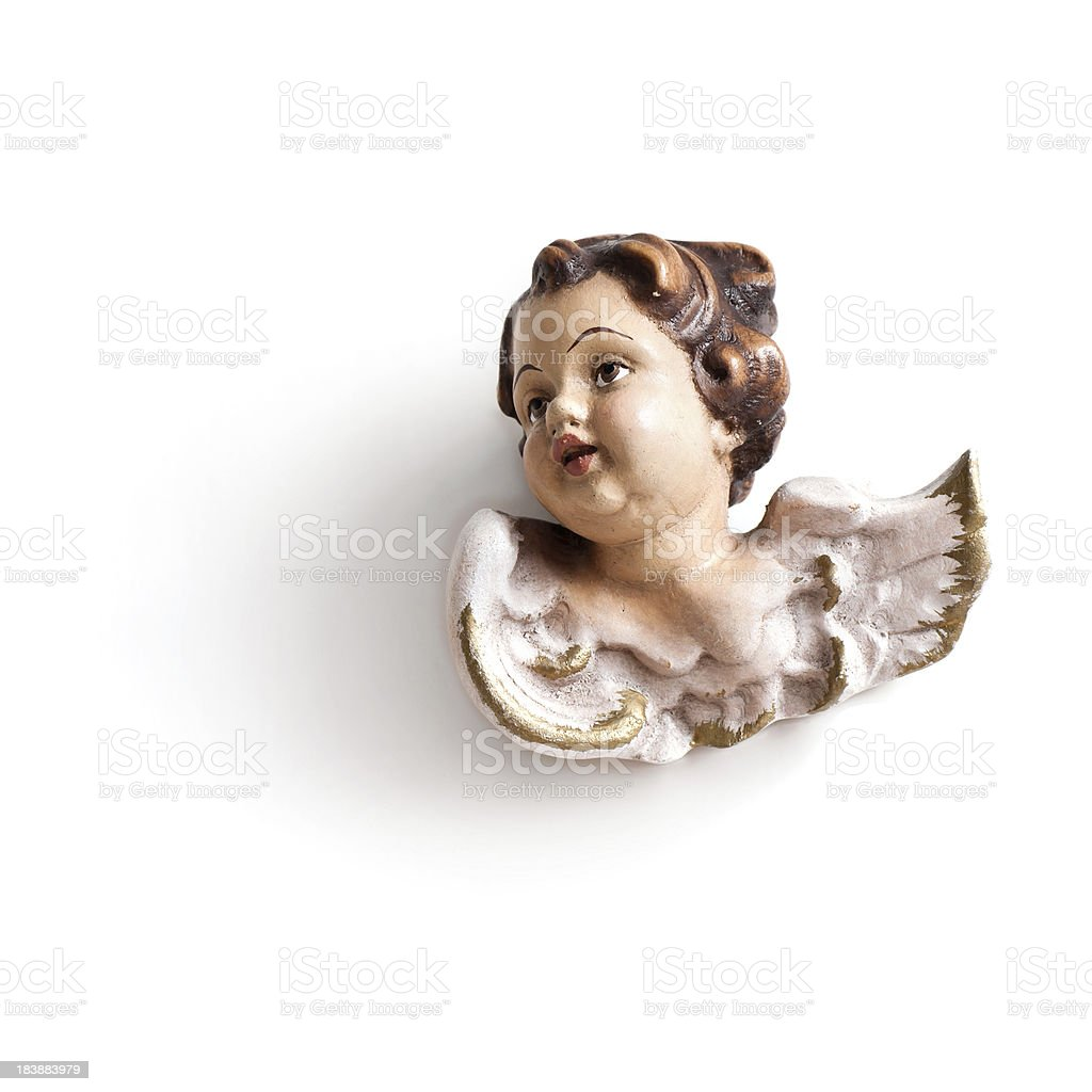 antique baby angel hanging on wall an protecting the house royalty-free stock photo