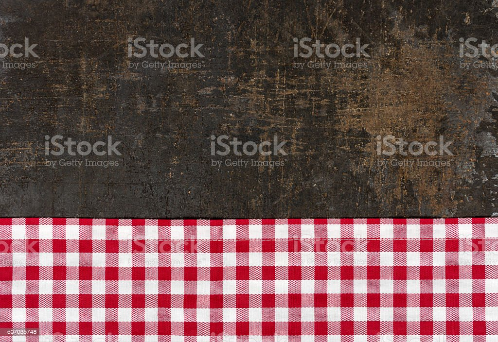 Antique baking tray with a red checkered tablecloth stock photo
