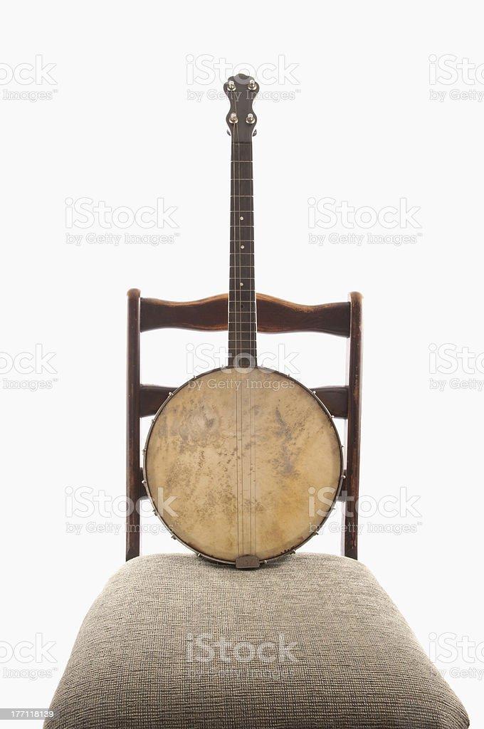Banjo na cadeira Vintage antiga foto royalty-free