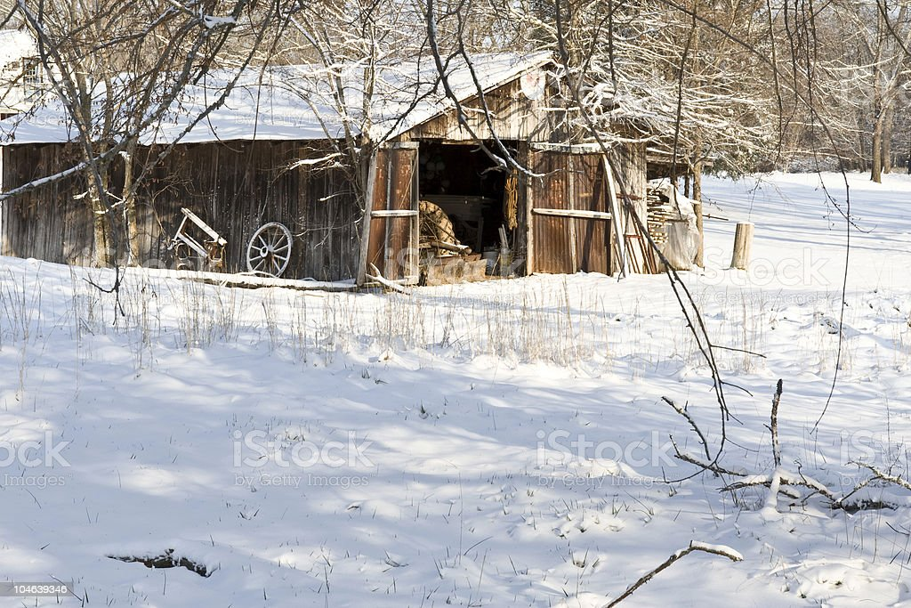 Antique barn in the snow stock photo